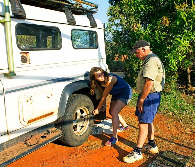 Louis showing me how to change a tyre for the first time! © Copyright Alexis Smith 2012 All Rights Reserved